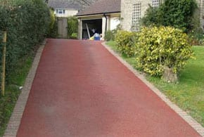 red coloured tarmacadam